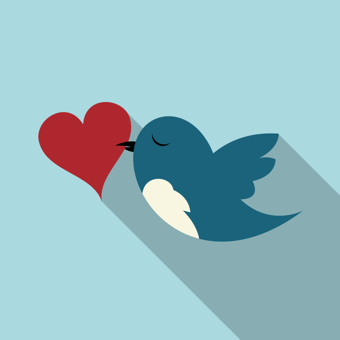 Twitter bird with a heart in it's beak
